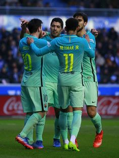 Lionel Messi (L) of FC Barcelona celebrates scoring their fourth goal with teammates Luis Suarez (2ndL), Neymar JR. (2ndR) and Andre Gomes (R) during the La Liga match between Deportivo Alaves and FC Barcelona at Estadio de Mendizorroza on February 11, 2017 in Vitoria-Gasteiz, Spain.
