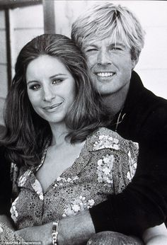 One more time: Robert surely could not believe his luck that he was getting paid to cuddle up to young Barbra