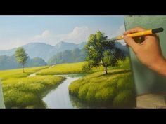 Watch and paint with me on this acrylic painting tutorial on how to make simple landscape with house and waterfalls. Thank you for watching! Website: www.jml...