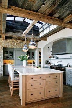 Kitchen island. Stone. Exposed beams.