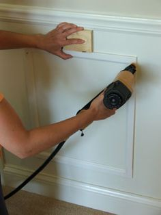 DIY Wainscoating tutorial - steps 6-9 are particularly helpful - do this onto the front of A's bedroom doors