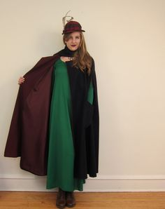 """lining view - nurse (or other) cape/cloak inspiration - Vintage cloak/cape w/ attached scarf/tie collar - navy blue wool w/ burgundy-red wool facing & satin lining; double snap closure at the throat; Armholes at each side; large apron pockets at front - Label: Images & Accents; 80% wool, 20% nylon; Measurements: shoulders: 21""""; from top of armhole to other armhole: 54""""; length 45"""""""