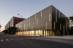 Parisian sports hall by Ateliers O-S Architectes with bands of light on its walls
