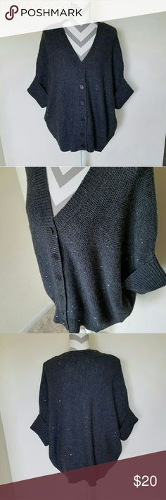 Oversized Sequin Cardigan Sweater! Charcoal colored sweater with silver sequins throughout. Sequins are small to just add a hint of sparkle without being overpowering. Buttons down the front. Cuffed batwing style sleeves. Replacement button in a bag attached to inside tag. Brand new without tags! Talbots Sweaters Cardigans