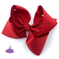 """Big Red Christmas Hair Bow! A big southern sized red bow that is beautifully shaped out of quality ribbon. Our bows are carefully made to have that gorgeous boutique bow shape that stays full when worn. The bow pictured measures over 7"""" wide and is made with 3"""" grosgrain ribbon. We only use premium hardware for more durability and repeat wear. All ends have been heat sealed to prevent fraying. It is lightly starched to hold its shape unless otherwise requested. Christmas Hair Bows, Red Christmas, Stocking Stuffers For Girls, Southern Boutique, Christmas Accessories, Boutique Hair Bows, Cheer Bows, Big Bows, Gifts For Girls"""