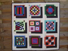 Interesting way to use sampler blocks - amish modern quilt