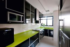 Cheerful Room Decor Ideas Cheers up Your Day: Long Black Kitchen Counter In Stylish Apartment Kitchen With Green Countertop And Black Cabine...