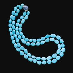 PROPERTY OF A PRINCELY FAMILY TURQUOISE, SAPPHIRE AND DIAMOND NECKLACE, BULGARI, Designed as two rows of polished turquoise beads on a clasp set with a cabochon sapphire and brilliant-cut diamonds, length approximately 630mm, signed Bulgari. Estimate    6,342 - 8,985USD  LOT SOLD. 26,425 USD