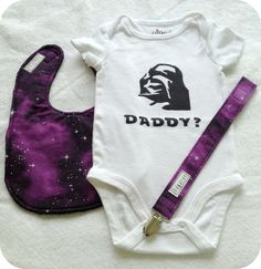 """Celebrate Embrace your Geekness Day on Friday, July 13th with a Darth Vader Galaxy Gift Set. Which includes a Stenciled and Painted Darth Vader """"Daddy?"""" onesie and galaxy themed bib and pacifier clip by bugarooboutique, $25.00"""
