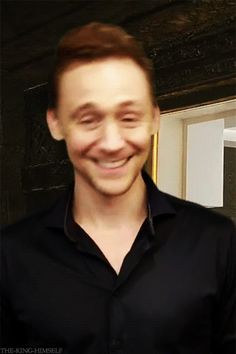Tom is adorable!!! XD *gif* and I can tell what the backdrop is its the prison from Thor 2