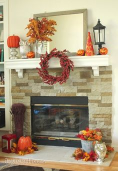 My Orange, Red, and Gold Fall Mantel.. with metallic pops of silver mercury glass via www.TheKimSixFix.com