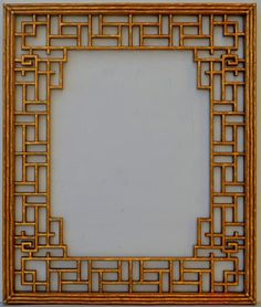 Intricate bamboo fretwork over the mirror on this Friedman Brothers mirror, available from Baker Furniture in Suite #112.