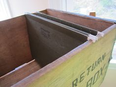Use an old wood crate and hanging folders for your paper pileups ~