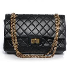 2e31c341f653 This is an authentic CHANEL Vintage Lambskin 2. 55 Reissue 225 Flap in  Black.