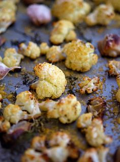 Parmesan-Roasted Cauliflower. Delicious! I'll never boil cauliflower again. I did double the onion and garlic (& I also pealed the garlic, not sure why you wouldn't)