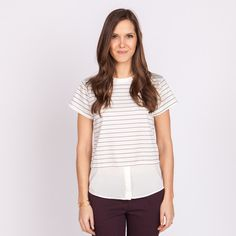 This essential knit top features skinny stripes and a faux layered blouse. Pair this with skinny jeans or trousers. Short sleeved. Fabric: Knit. Self: 97% polye
