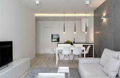 Küche, Tv Sideboard und Sofa in weiß, Arbeitsplatte und Pendelleuchten in schwarz