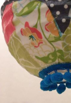 """Patchwork style using a collection of colorful fabric swatches. Very eclectic and definitely one of a kind - this lantern will add a unique look to any space.  6"""" (measuring from top to bottom) handmade latern."""