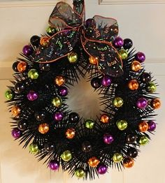 Toothpick Halloween wreath!! (Used a wire hanger styrofoam balls toothpicks spray paint ornaments and ribbon!) Easy peasy!