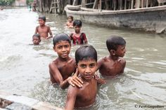 Kids bathing in a river, Barisal, Barisal District, Bangladesh, Indian Sub-Continent,