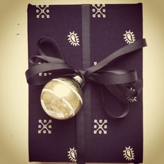 pocket square-wrapped gifts via Haskell Harris magpiebyhaskellharris.blogspot.com