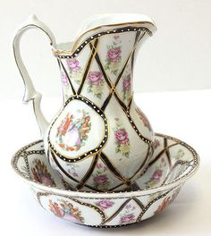 Victoria ironstone French porcelain wash bowl with matching pitcher.
