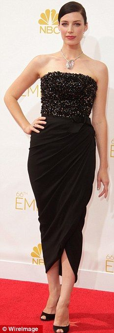 Mad Men star Jessica Pare looked sophisticated in a sleek pencil skirt at the 2014 Emmys http://dailym.ai/1lufdYb