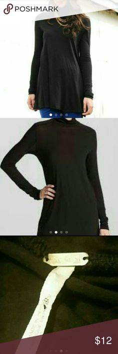 Free People Tunic Turtle neck style with long sleeves. Soft , thin material.   Very soft.  Sz XS  -- can fit a small also but sz xs for more loose fit.  Not fadded. Picture #4 was taken with bad lighting, sorry. Free People Tops Tees - Long Sleeve