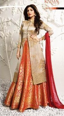 Be an angel and create and establish a smashing influence on everyone by wearing this Shilpa Shetty beige and orange jacquard, raw silk and viscose long choli lehenga. The lovely embroidered, resham a. Lehenga Choli Designs, Kurta Designs, Long Choli Lehenga, Lehnga Dress, Kurti Designs Party Wear, Silk Lehenga, Lehenga Suit, Indian Designer Outfits, Indian Outfits