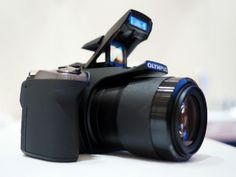 The Olympus SP-100 iHS Ultrazoom camera.
