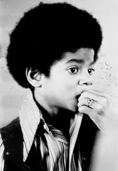 Michael Jackson as a young boy. The cutest thing ever!