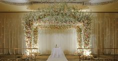 Beautiful - Ivory and peach flower alter arch by Preston Bailey Design