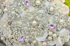 Deposit on a pearls and pastel brooch bridal bouquet  by Noaki, $310.00