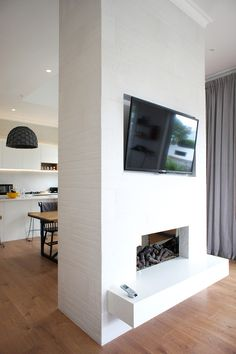 Cat & Jeremy's kitchen and living fireplace, uses the Track Brick Porcelain tile