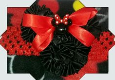 Minnie Mouse bow head band made by Norma's Unique Gift Basket.$6.99