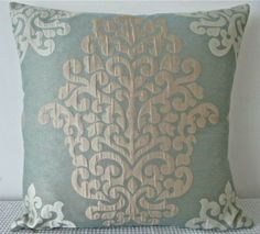 Damask duck egg blue, champaigne and off white... what do you think of the colors and textures in this? for the middle room/hallway. -EMILY