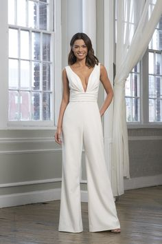 Theia's 'Faye' is a deep V crepe jumpsuit with ruched waistband. This jumpsuit is the perfect look for a wedding reception outfit! Retro Wedding Dresses, Wedding Dress Sizes, Wedding Gowns, Designer Jumpsuits, Theia Bridal, Bridal Gown, Bridal Dresses, Wedding Reception Outfit, Women's Fashion Dresses