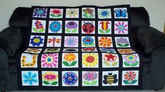 Stephanie Bunge Adams  Just got my Flower Festival quilt back from my quilter. The quilting is phenomenal!!!
