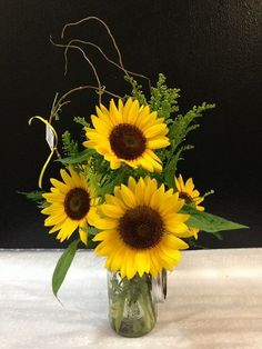 Flower delivery in Altamonte Springs by Altamonte Springs florist - Locally grown sunflowers beautifully arranged in a mason jar - curly wil...