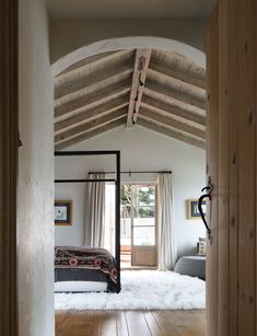 Spanish colonial bedroom old world feel with global modern styling