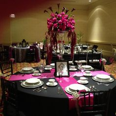 This is what i was thinking for linens....the black table cloth and maybe one or two fuchsia sashes drapped across