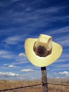 Cowboy Hat on Barbed Wire Fence, British Columbia, Canada