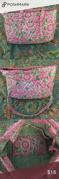 """Vera Bradley Tote No idea which bag this is.  Zipper at top.  Two inside pockets.  1 small outside pocket and 1 large outside pocket.  16"""" strap.  Bag is 11"""" tall and 15"""" wide with a 6"""" gusset.  Small stain on the bottom.  I've heard you can wash these in washing machine but I've yet to try.  Price reflects the stain.  Until I zoomed in to take the pictures I didn't notice the stain.  Happy to take additional images!  I THINK this is the get carried away tote.  Can't remember the print. Vera…"""