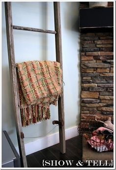 what a cool fall decorating idea. Throw can be changed to match seasonal colors. I reallylove this idea for hanging mittens and scarves after playing outside as well! Scarf Storage, Old Ladder, Season Colors, Show And Tell, Coastal Style, Decorating Tips, Ladder Decor, Something To Do, Family Room