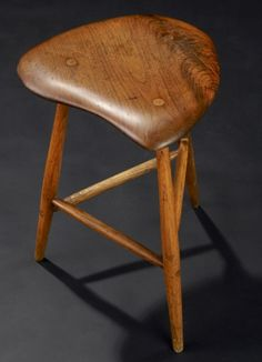 wharton esherick   WHARTON ESHERICK Three-legged sculpted walnut stoo