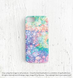 Pastel iPhone 4 case. To make paint a plain white or clear case with water then drip with watercolors. Let dry. Add another layer or water and drop small pieces of salt onto it. This is what you will get.