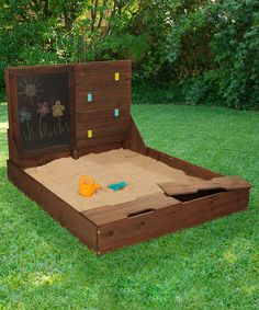 Add a chalkboard area to the underside of the sand box lid. Maybe even a magnetic area on the right or clothespins for the kids to play house outside with. :)