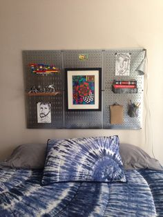 DIY magnetic metal pegboard headboard. I am excited about all the possibilities for this kid headboard alternative! Art display, book shelf, Lego display, pencil holder, sketch book/journal hook...pretty much anything you can imagine can hang on a hook or stick with a magnet!  We may ultimately frame it in some way, but for now I think it looks great as-is.