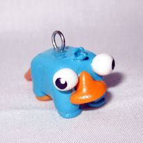 """Handmade out of polymer clay  Since this item is handmade it may look a bit different from the photos.  If requested this charm can be provide with one of the following: A Key Chain, Cell Phone Charm or 18"""" Necklace Chain. If none is specified, the charm with be shipped by itself."""