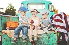 Love...old truck with kids in back.  All American.